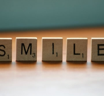 Scrabble spelling smile